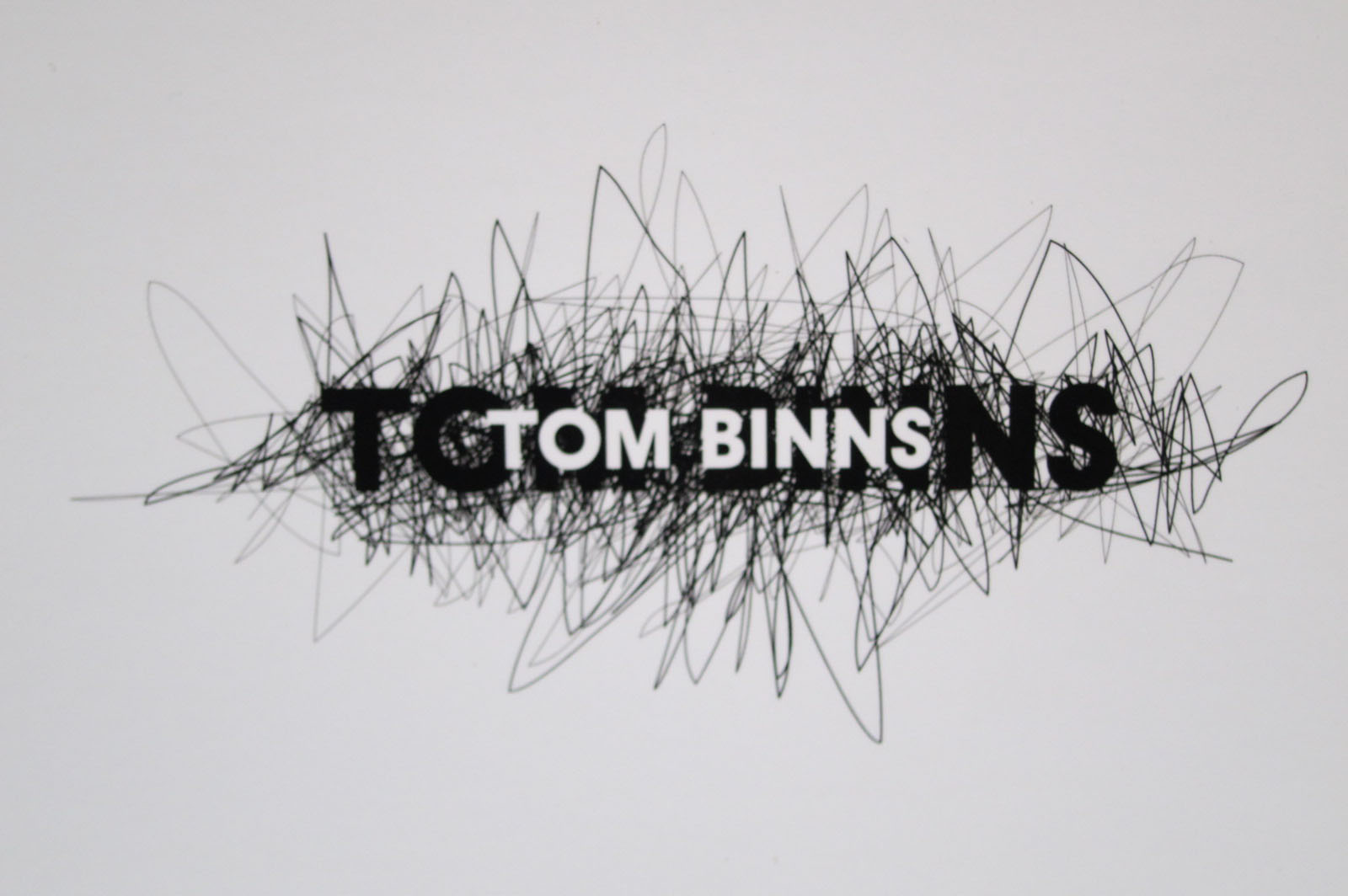 Tom Binns Logo Wallpaper